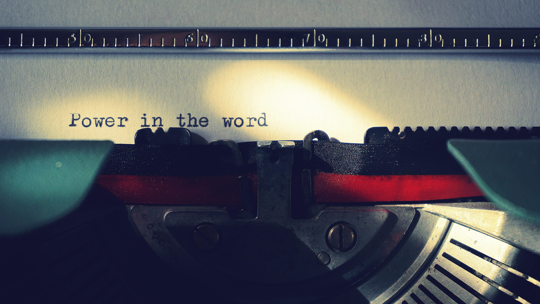 hiring a great copywriter typewriter